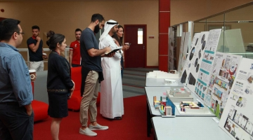 Judges view student projects